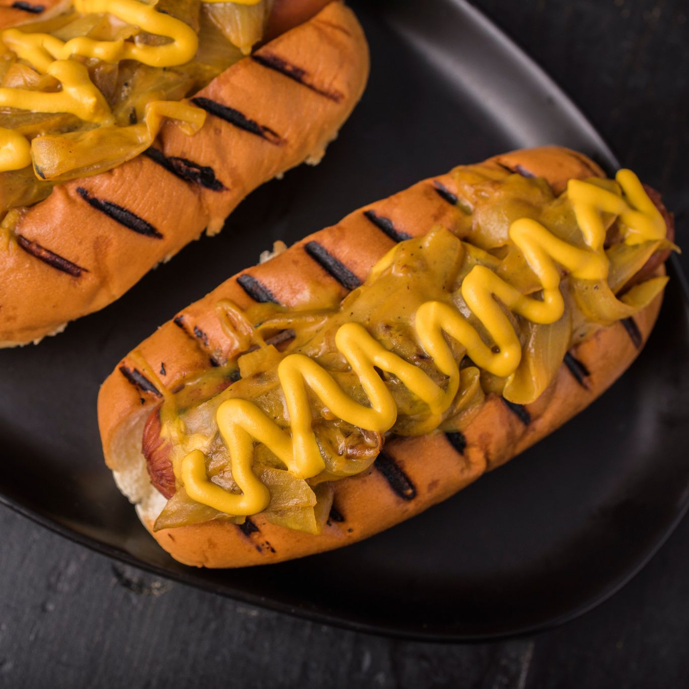 Grilled Hot Dogs with Beer-Mustard Onions