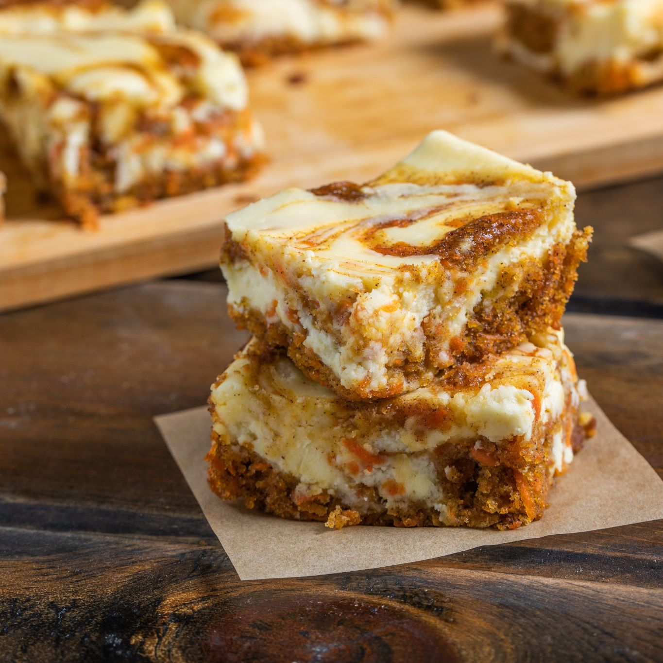 Carrot Cake Swirled Cheesecake Bars