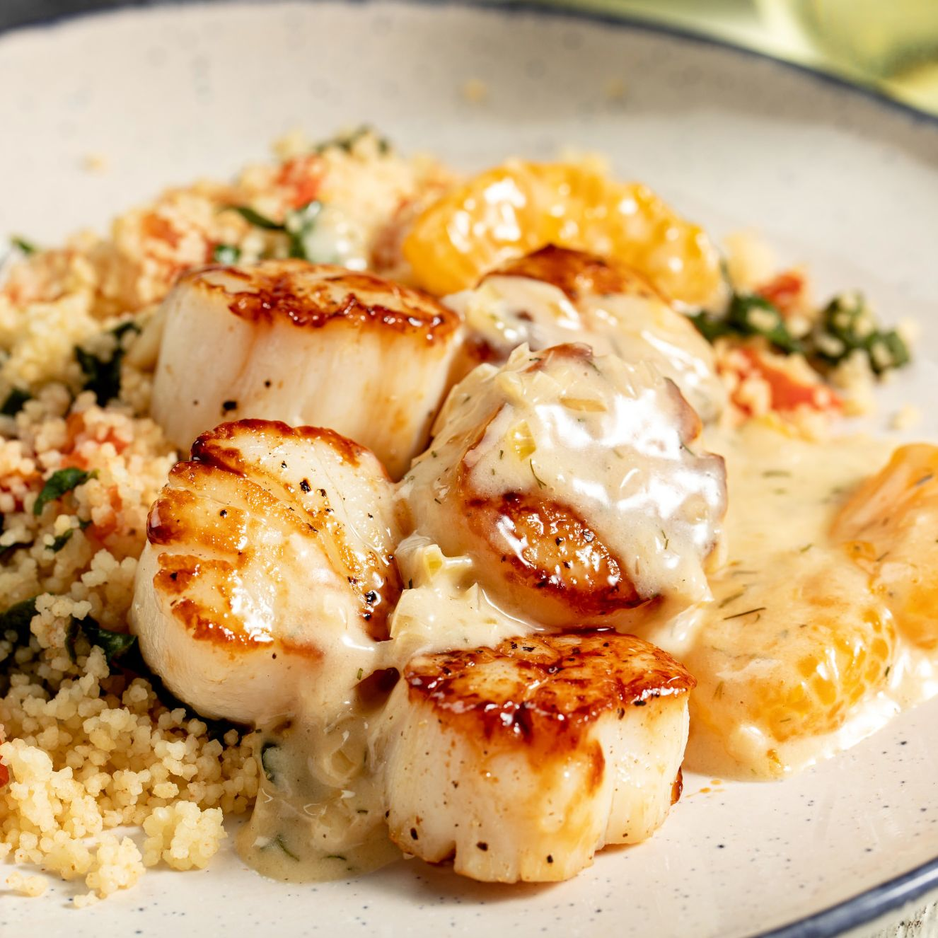 Seared Atlantic Calico Scallops with Citrus Dill Butter and Spinach Couscous