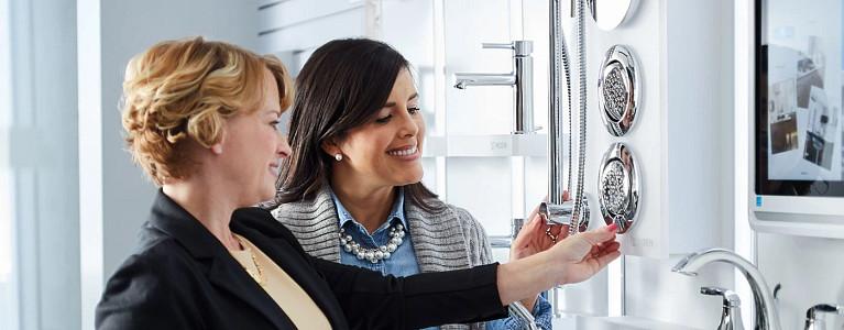 Moen Professionals Looking over Spa Components in the Showroom
