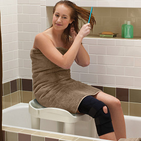 Woman Sits in Tub on Safe Chair