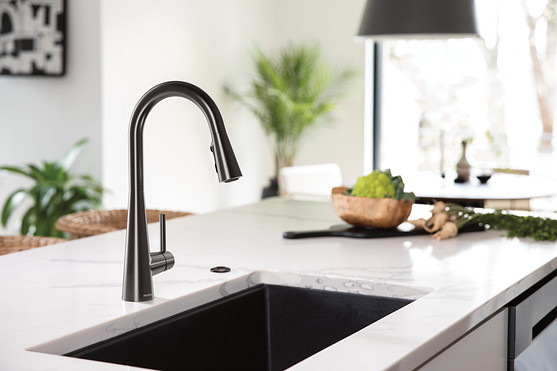 The right surfaces can help green a kitchen by reducing the need for artificial light