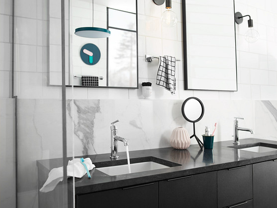 Keep a cohesive design aesthetic in the kitchen and bathroom