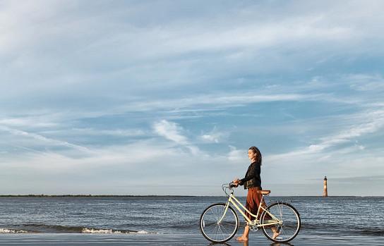 Woman on Beach with Bike