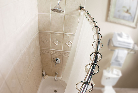 Install a curved shower rod for a truly unique look