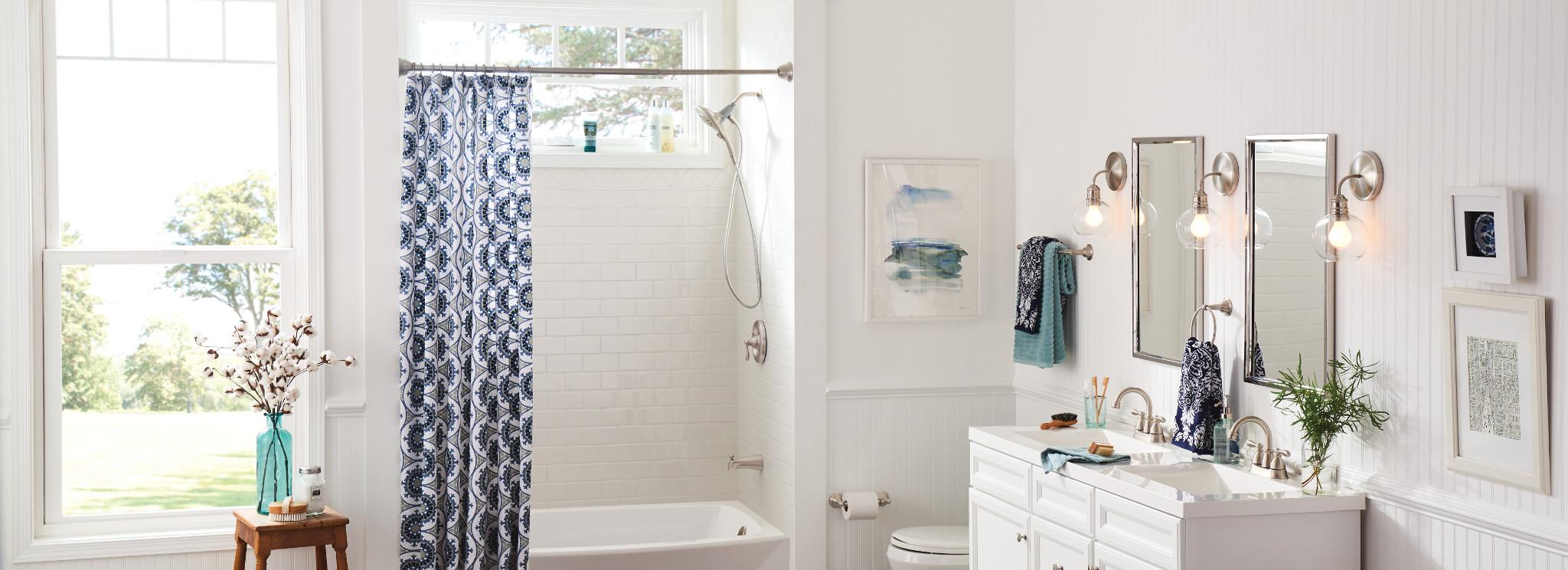 Bathroom with Moen Magnetix Curved Shower Rods