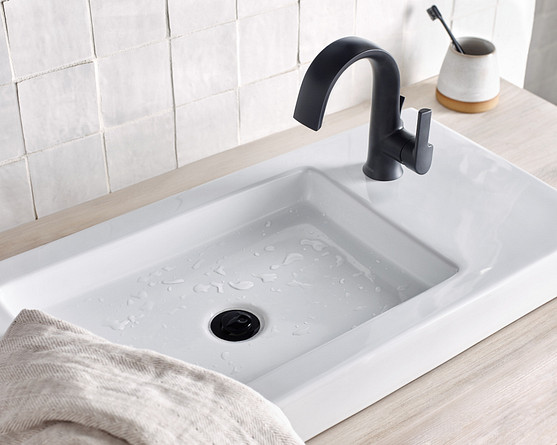 Modern bathroom design featuring a Doux matte black high arc bathroom sink faucet