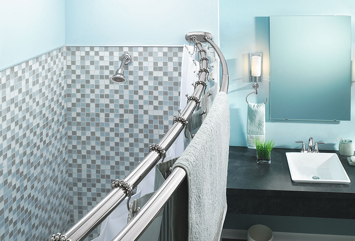 Featuring the Moen Adjustable Curved Shower Rod