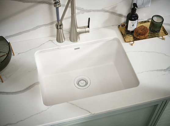 Select a granite, quarts, or marble sink instead of a stainless steel sink