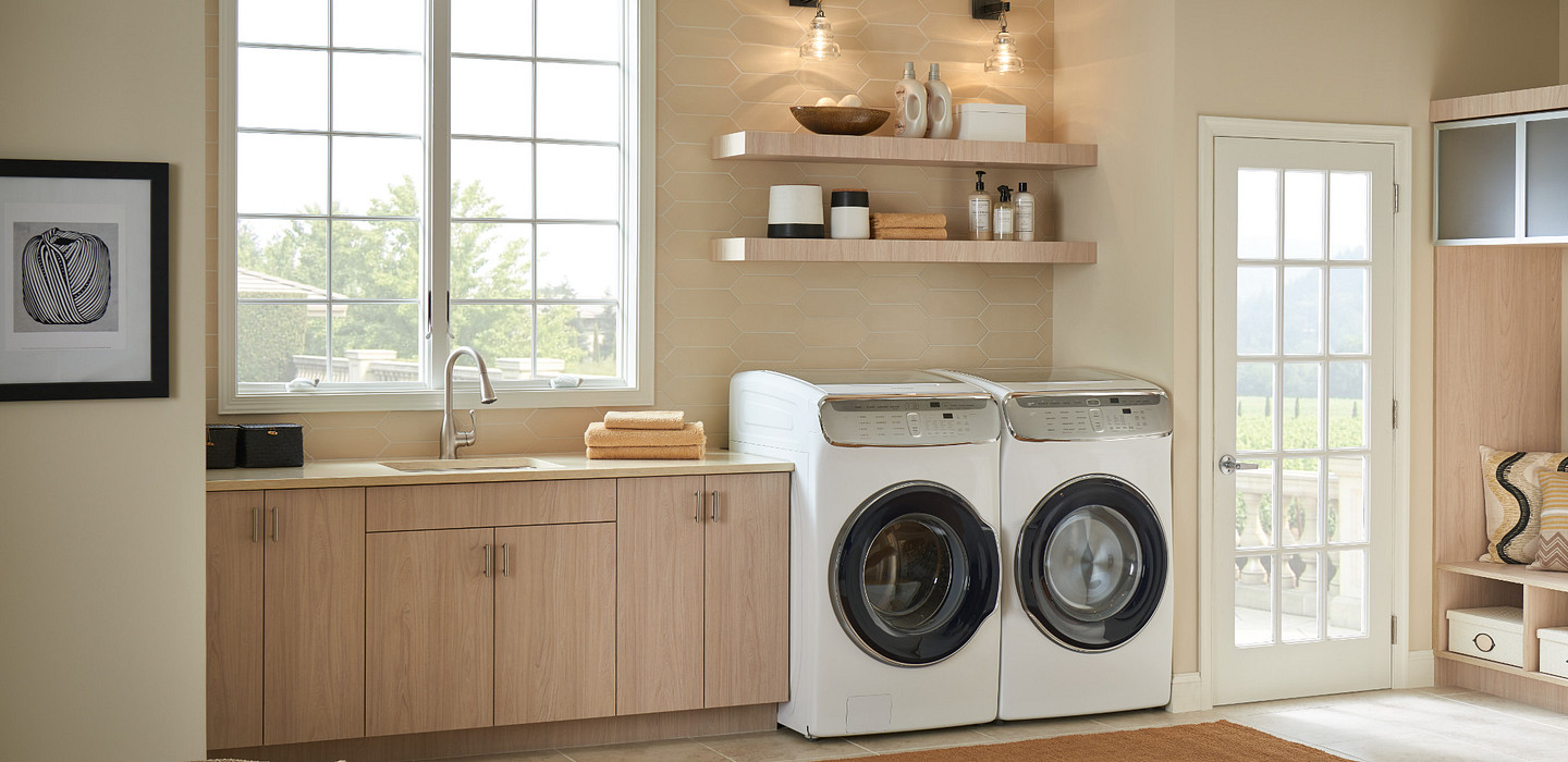 Buy an appropriate sized washer and dryer for the laundry room