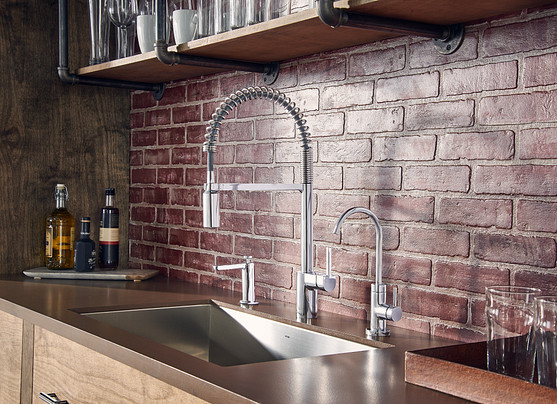 An undermount sink is installed under the counter