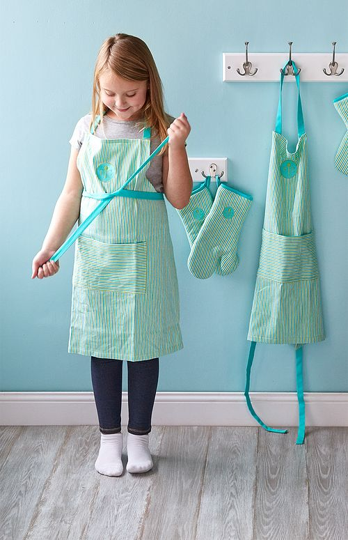 Child putting on an apron