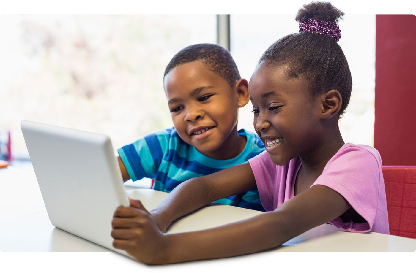 Children reading on laptop