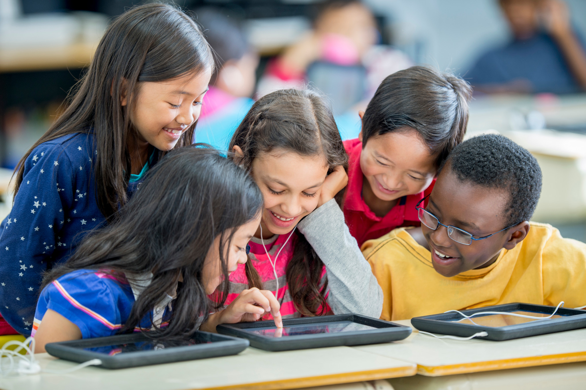 Students reading tablet