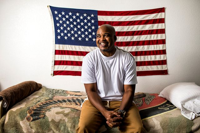 Veteran-smiling-with-American-flag