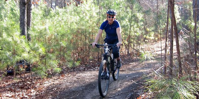 Biker on trails in South Carolina's Harbison State Forest