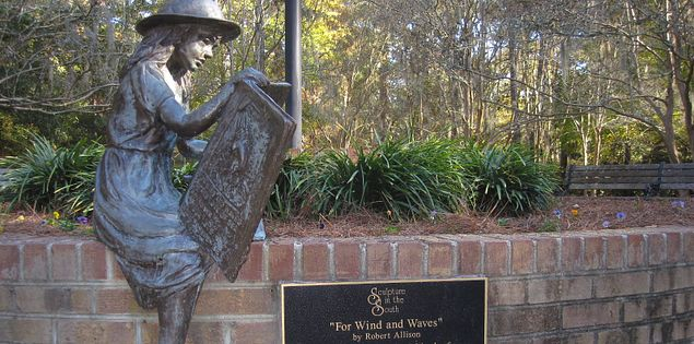 Sculpture of a girl sitting on a wall in Summerville, South Carolina