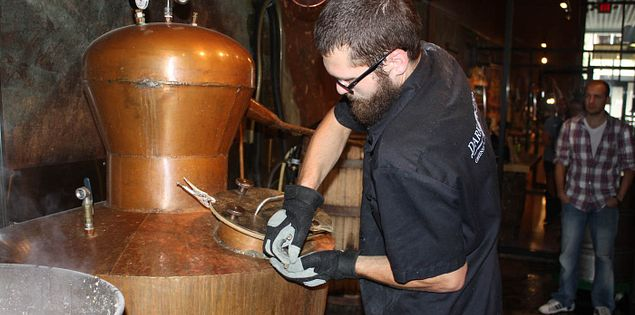 South Carolina's Paul Fulmer feeds the still at Dark Corner Distillery in Greenville