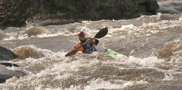 Millrace Massacre kayaker paddling through Lower Saluda River rapids in Columbia