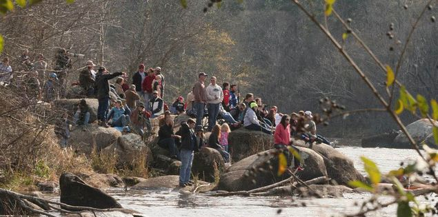 Spectators watching Columbia's Millrace Massacre on the Saluda River