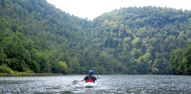 Kayaker paddling through Lake Tugaloo on South Carolina's Chattooga River