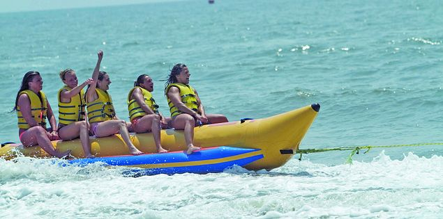 Riders on a Banana Boat inner tube on the shore of Myrtle Beach, SC.