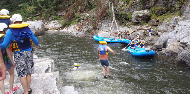 Rafters jumping into the Chattooga River in South Carolina's Upstate