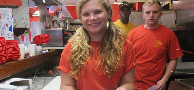 Employee Mikayla Carr shows off Jack's Cosmic Dogs most popular hot dog