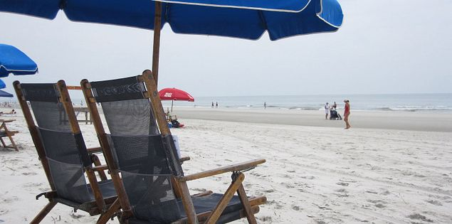 Blue umbrellas and beach chairs for rent on Hilton Head Island