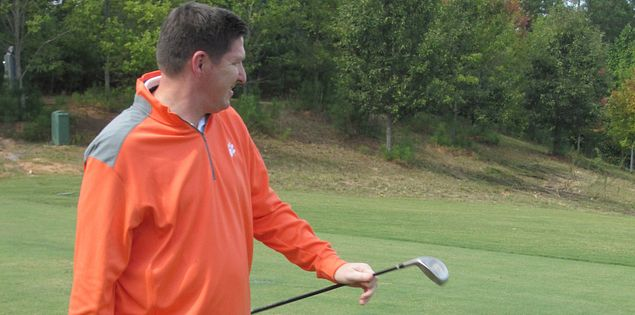 Brad Brownell golfing in South Carolina