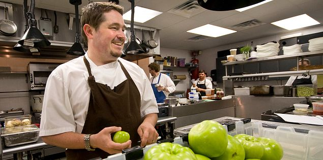 Chef Sean Brock of McCrady's preparing green tomatoes for pickling