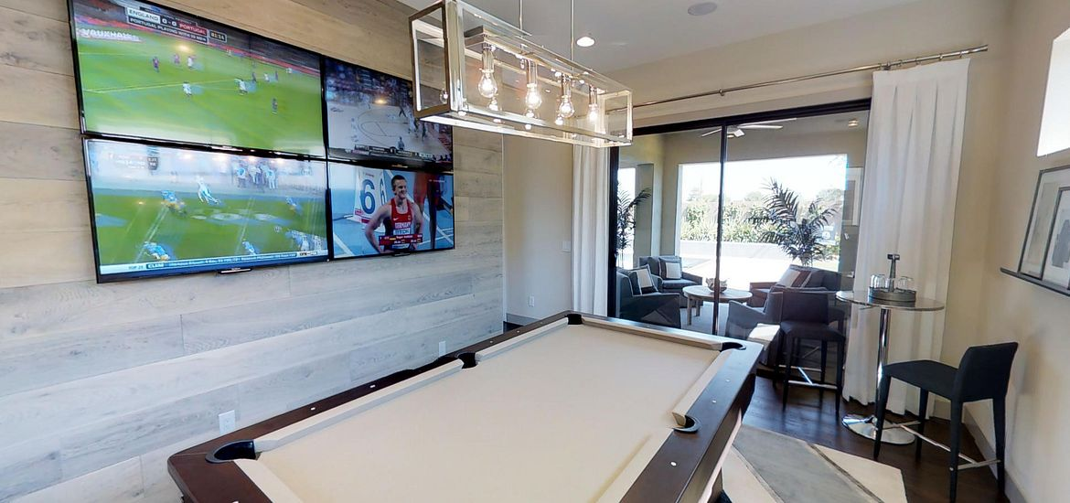 Flex Room design for an entertainment area with screens and pool table