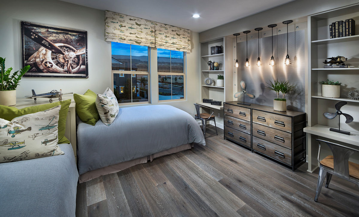 Plan 3 child's bedroom with two twin beds, wood floors, dresser, built-in bookshelves, and pendant lights