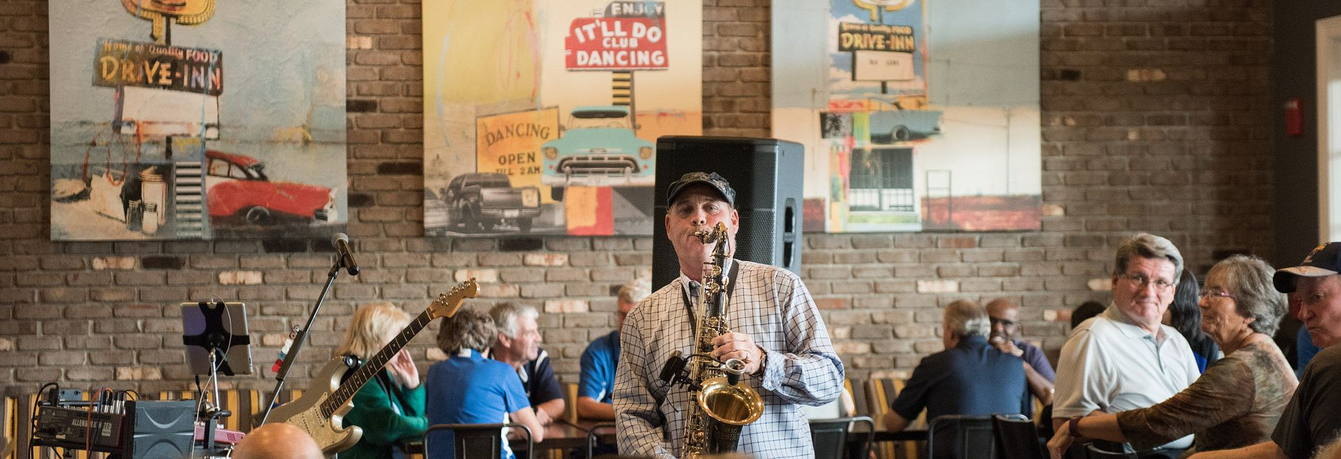 Man playing the saxaphone in The Grille