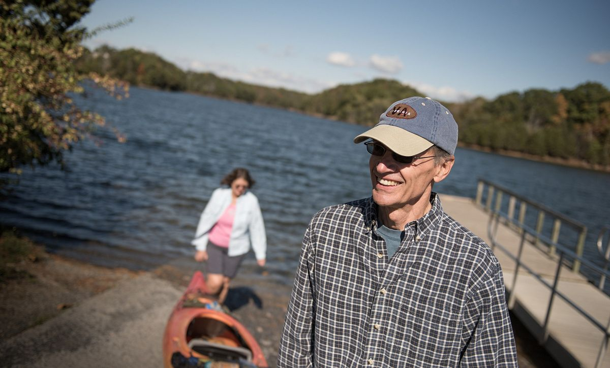 Couple Launching Boat from Lake Frederick