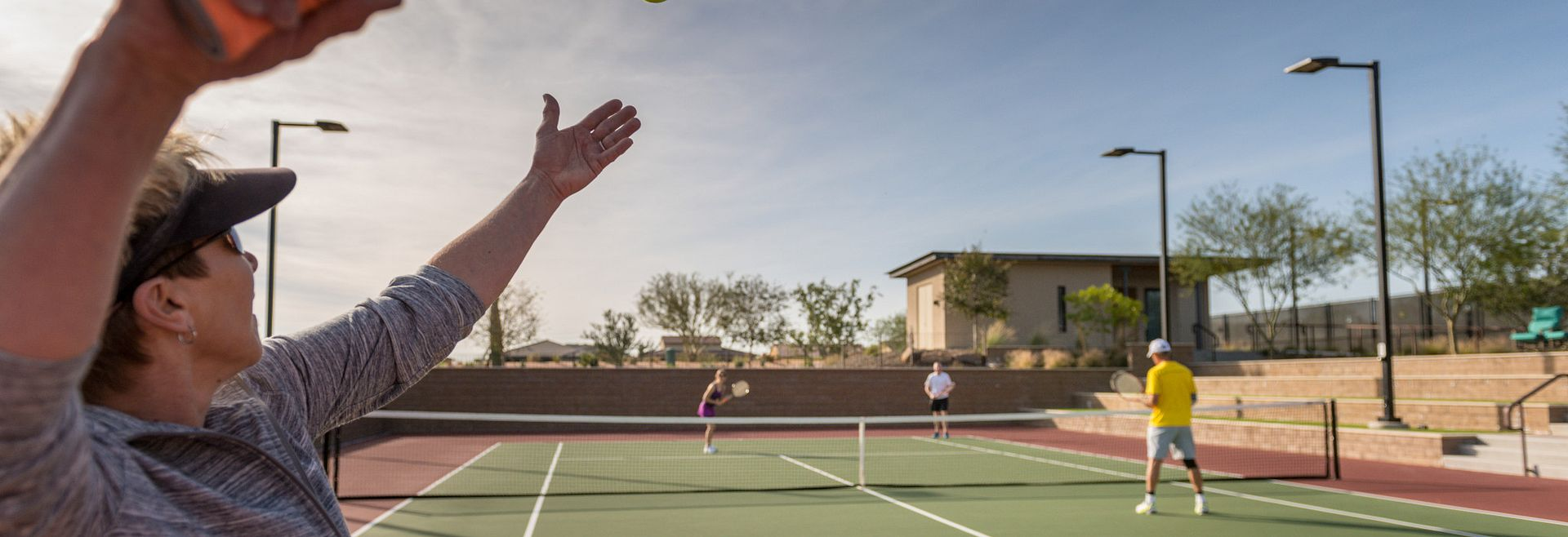 Trilogy Homeowners Play Tennis