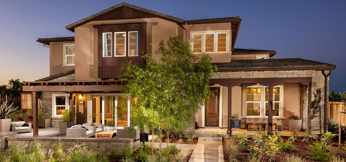 Big house with front patio and garden at Vista Dorado in Brentwood, CA