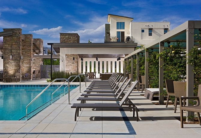 The District at Northridge Pool Area Surrounded by Cabanas and Lounge Chairs