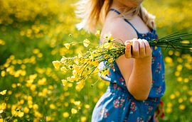Girl with Flowers In Field