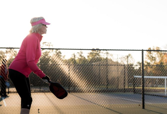 Lady playing Pickleball