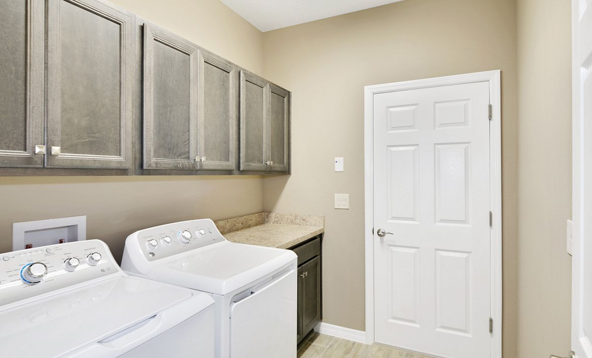 Trilogy at Ocala Preserve Quick Move In Home Naples Laundry Room
