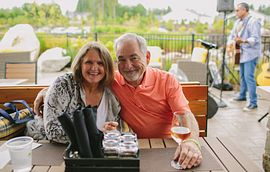 Couple enjoying a glass of wine at Trilogy® at Tehaleh®