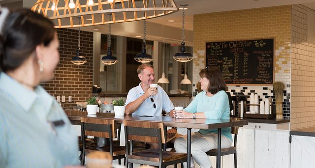 Couple enjoying coffee at Trilogy Lake Norman's Coffee Shop