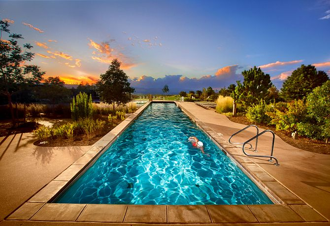 Lap pool against the sunset sky at The Sundial House