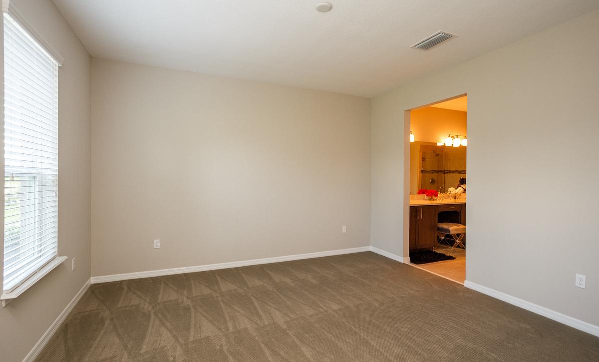 Trilogy Orlando Affirm Model Home Master Bed