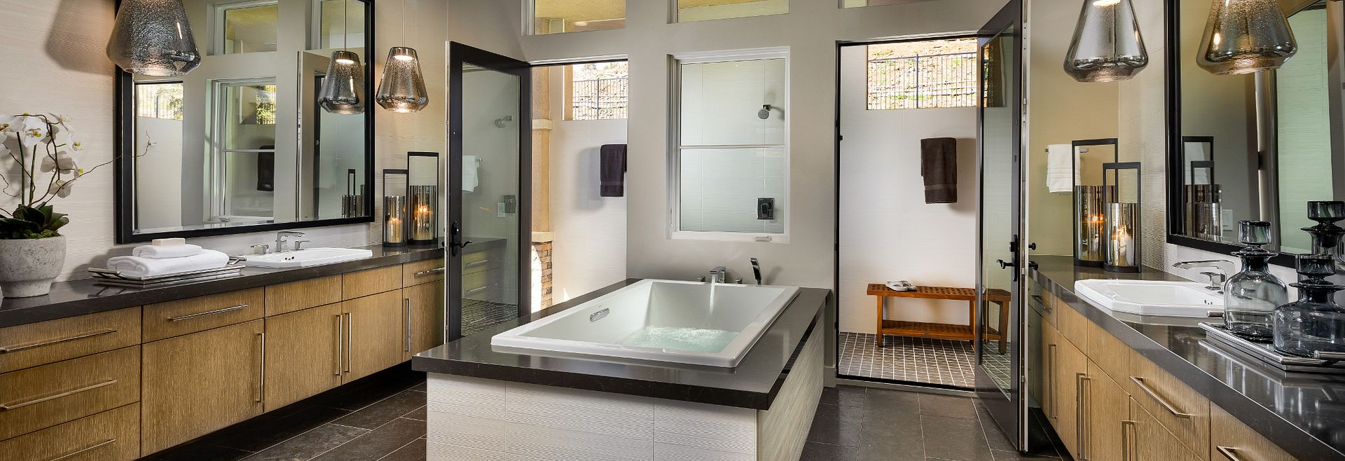 Plan 5 Master Bathroom with soaking tub, pendant lights, and double vanities