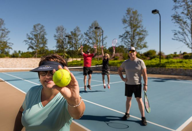 Trilogy Homeowners Playing Tennis