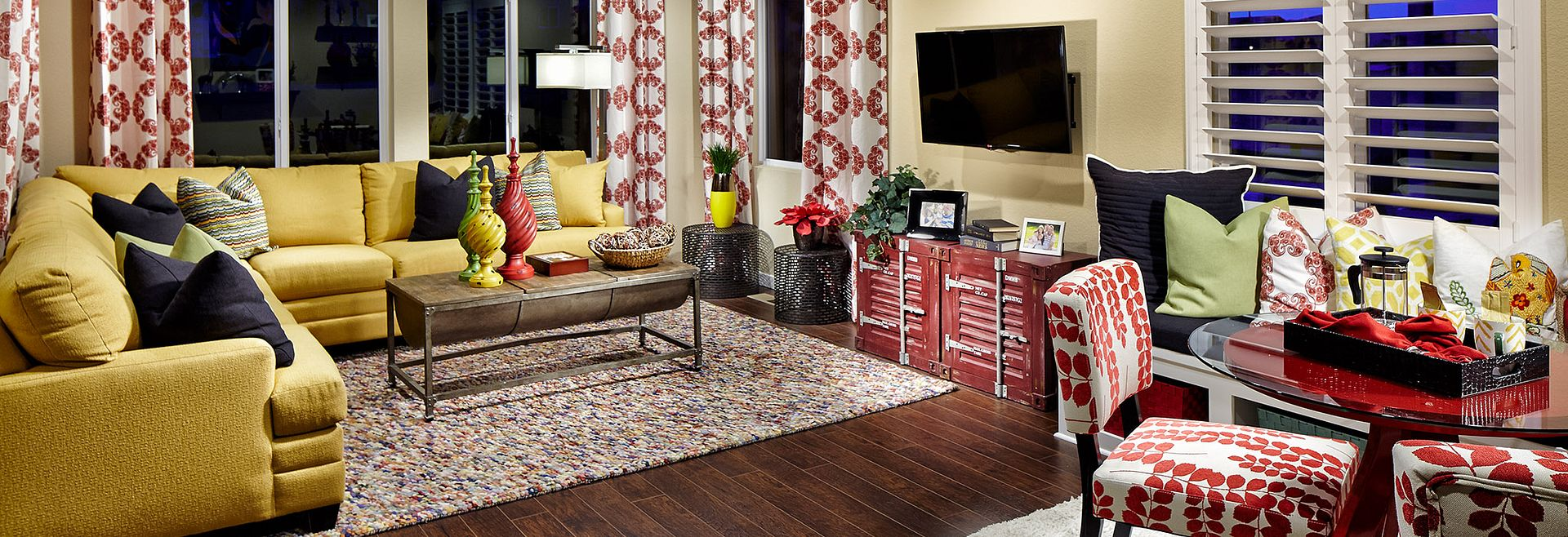 SPACES Discovery Plan 3507 family room with sofa, area rug, windows, and drapes