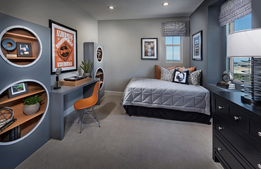 Plan 2 child's bedroom with bed, built-in desk, desk chair, poster, dresser, and table lamp