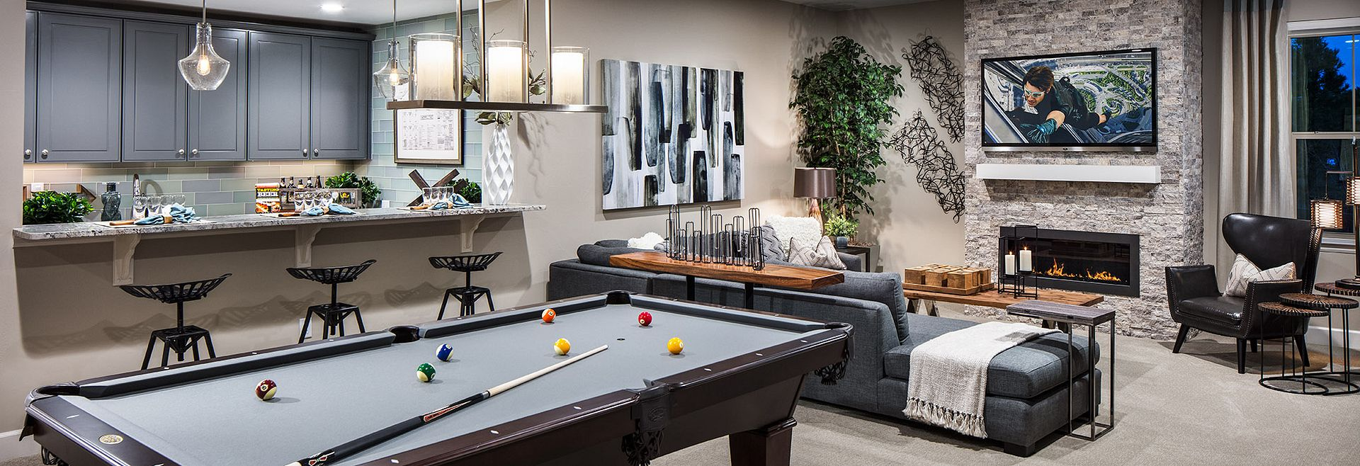 Recreation room with pool table and TV